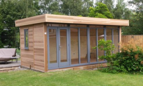 Cedar Clad 5m x 3.6m Contemporary Garden Office with an Anthracite Grey finish to doors and sidelights and completed with galvanised guttering