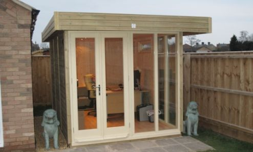 The 2.4m x 3.8m Contemporary Office with Doors and Sidelights treated in Country Cream Wood Protector. The security system includes triple glazing, multi-point locking and two highly trained guard dogs