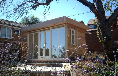 A popular sized Garden Office at 3.6m x 2.4m clad in Cedar with joinery finished in Natural Stone Wood Protector. The 400mm overhang features exterior lighting which illuminates the patio and creates a focal point in the garden after nightfall