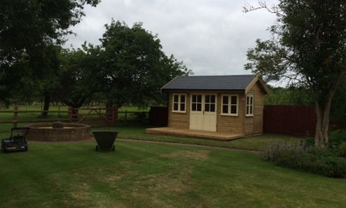 A Traditional Style Garden Room which fits well into this established garden. Featuring Double Doors, Tapco Slate Roof and a small decked area infront the building would make an ideal Office, Retreat or Studio